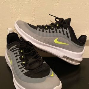 Black white and lime green Nikes